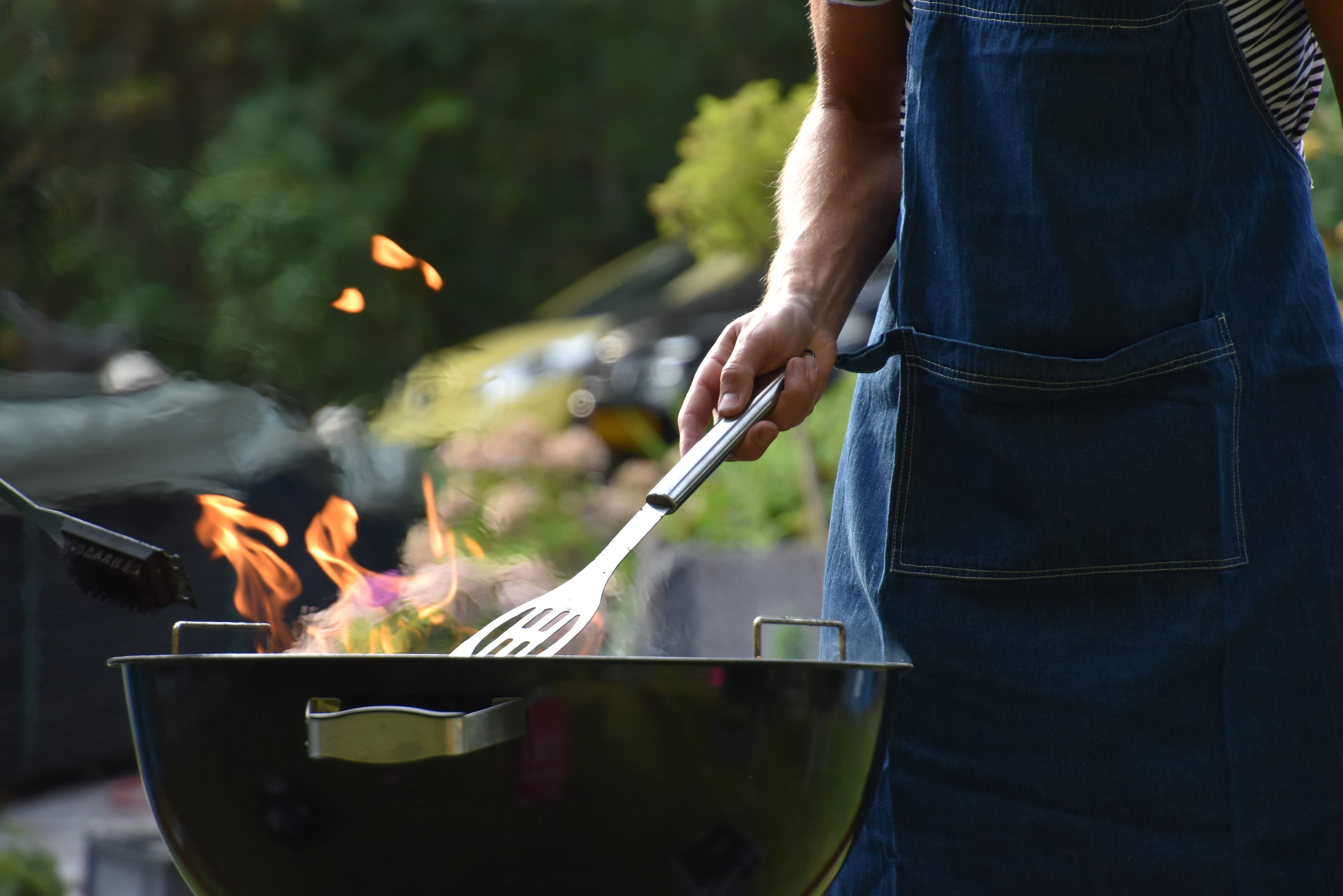 male cooking on BBQ